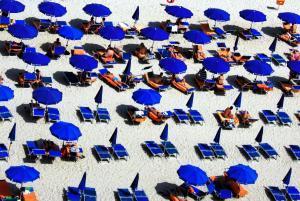 beach with duplicate umbrellas