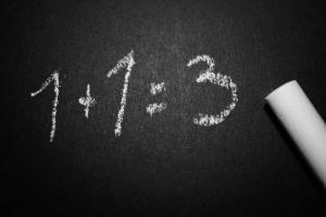 1 plus 1 equals 3 on chalkboard