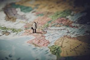 tiny model man on a map