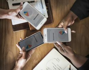 3 smartphones displaying'branding' pie chart
