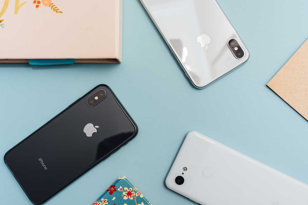 Shows a collection of iPhones on a desk