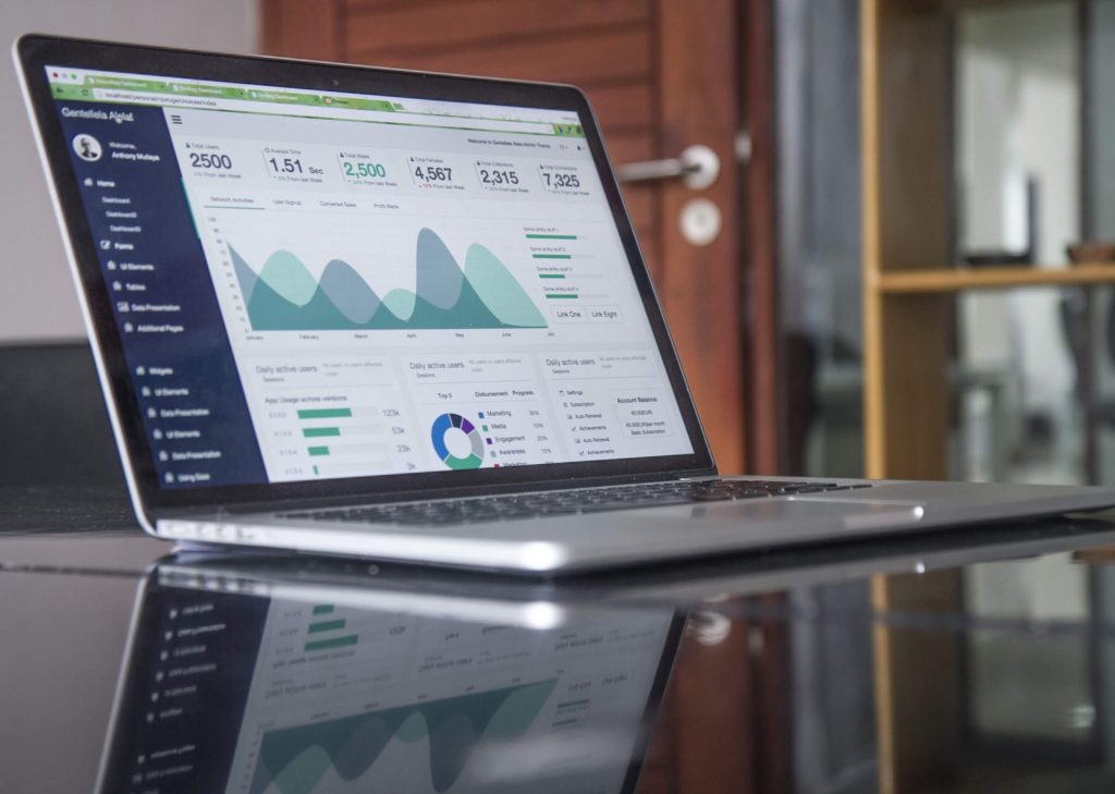 How to perform a website content audit - Shows a report on a laptop