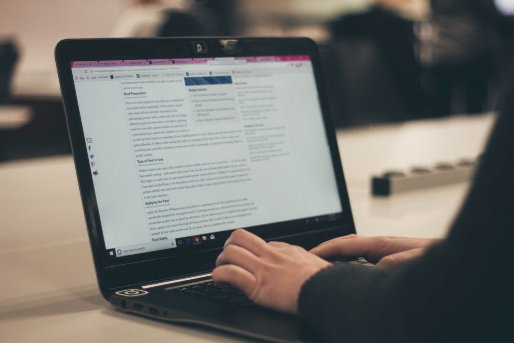 How to improve your website copy - Shows a person editing a webpage