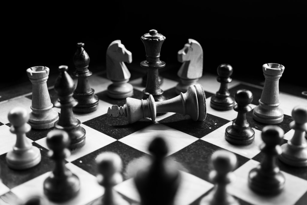 How to improve your website copy - Fallen king on a chess board